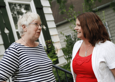 Cheryl Youakim with Community Member at Door